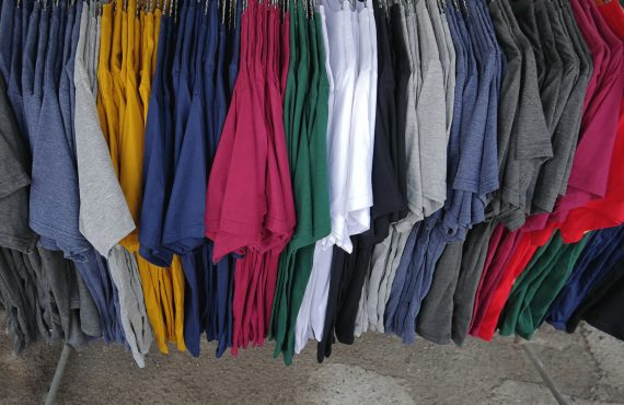 coloful plain casual t-shirts hanging on the rack