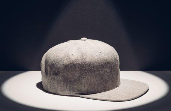 gray baseball cap in a round spot of light