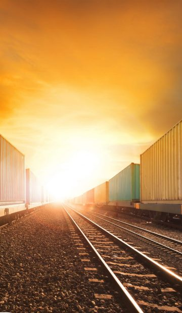 industry container trainst running on railways track against beautiful sun set sky use for land transport and logistic business